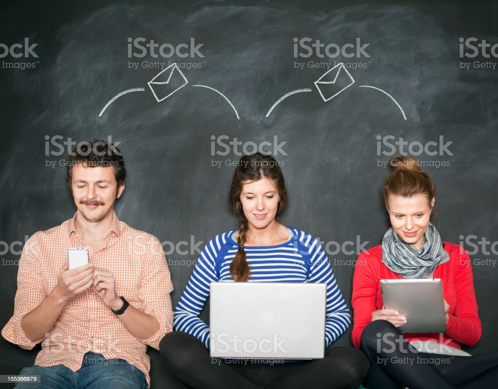 People sending emails royalty-free stock photo