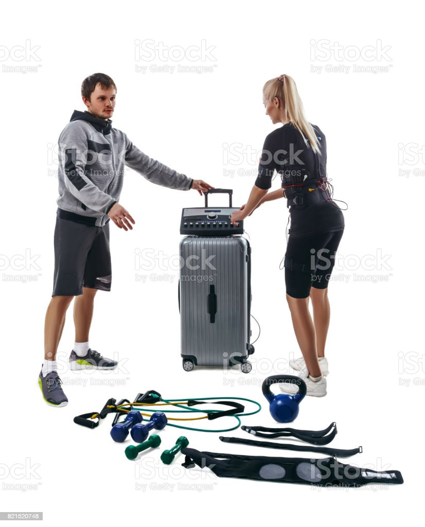 People setting parameters of EMS station stock photo