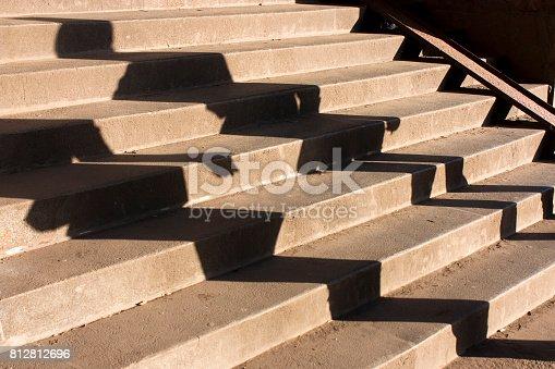 812812808istockphoto People shadow on stairway 812812696