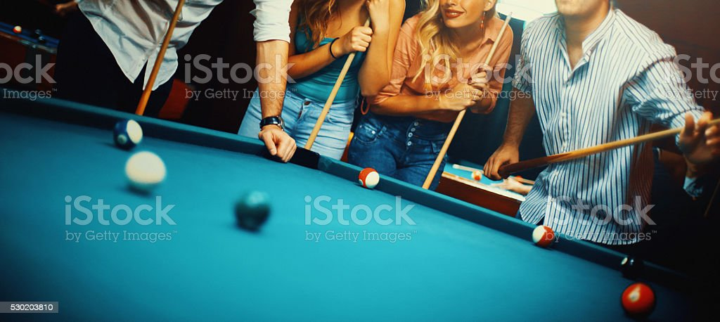 People shooting pool. stock photo