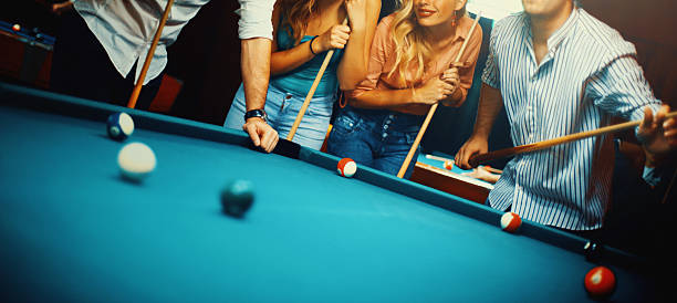people shooting pool. - cue ball stock pictures, royalty-free photos & images