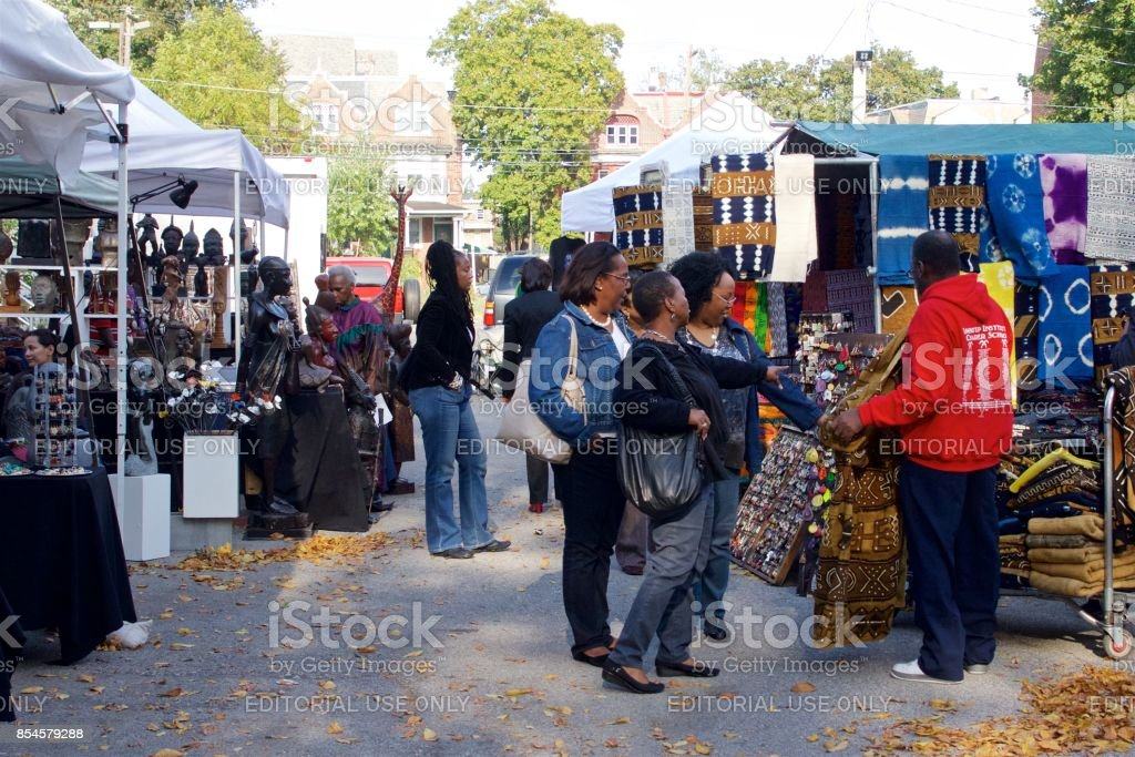 People shop and enjoy an outdoor African-American Art Fair stock photo