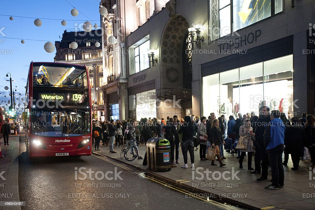 People shopping and double decker bus in London stock photo