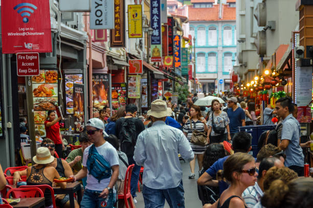 People shopping and eating in Chinatown - Singapore stock photo