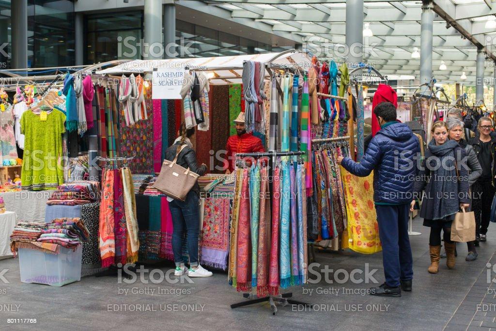 London, UK - October 2016. People shopping around stalls in Old Spitalfields Market. Shoreditch, East London,UK stock photo