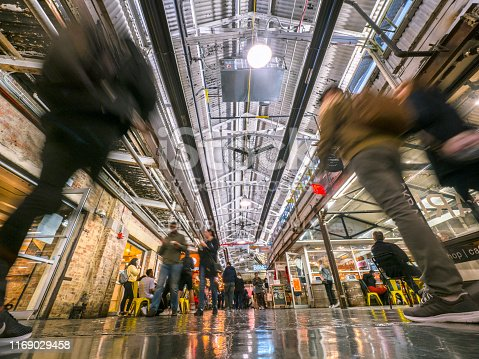 New York City, USA - May 03, 2019: People shopping at Chelsea Market - a food hall, shopping mall, office building and television production facility located in the Meatpacking District at 75 Ninth Avenue of the borough of Manhattan