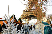 PARIS, FRANCE - DECEMBER 26, 2015: People shopping at Christmas market near Eiffel tower.