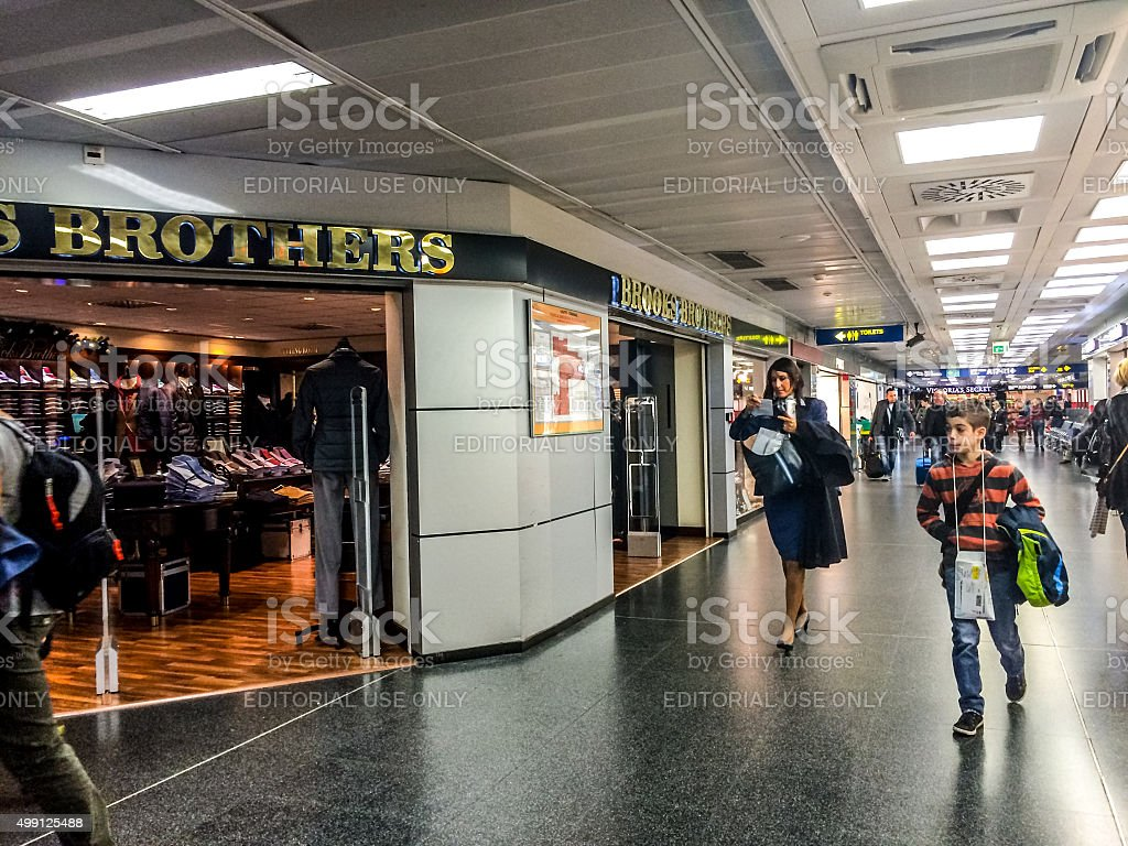 People shopping at Linate Airport, Milan stock photo