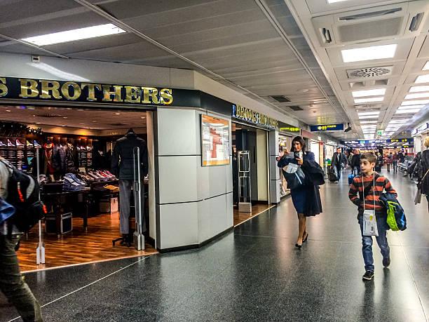 People shopping at Linate Airport, Milan stock photo