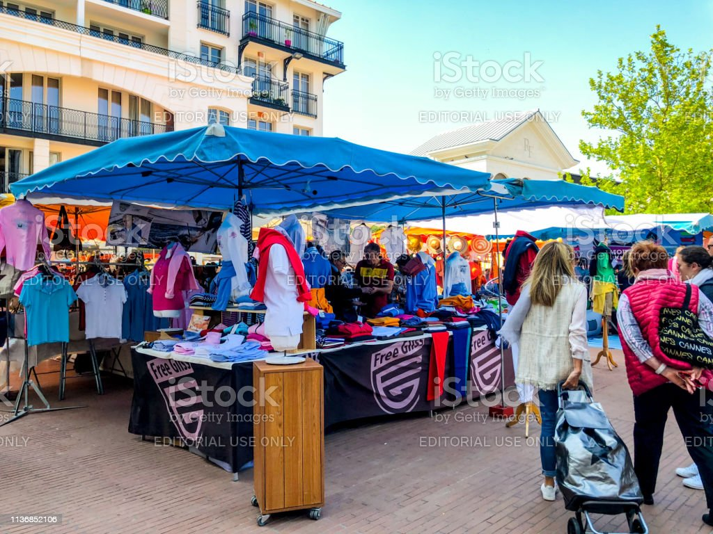People shopping at local outdoor market in Arcachon downtown, France