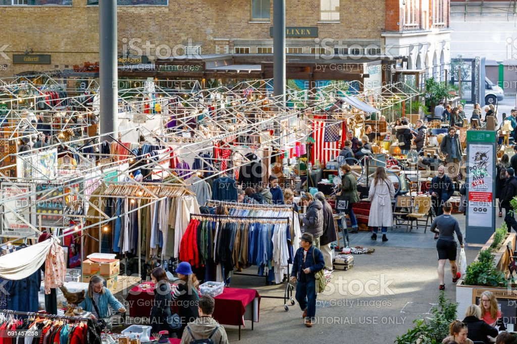 People shopping at Old Spitalfields Market in London stock photo