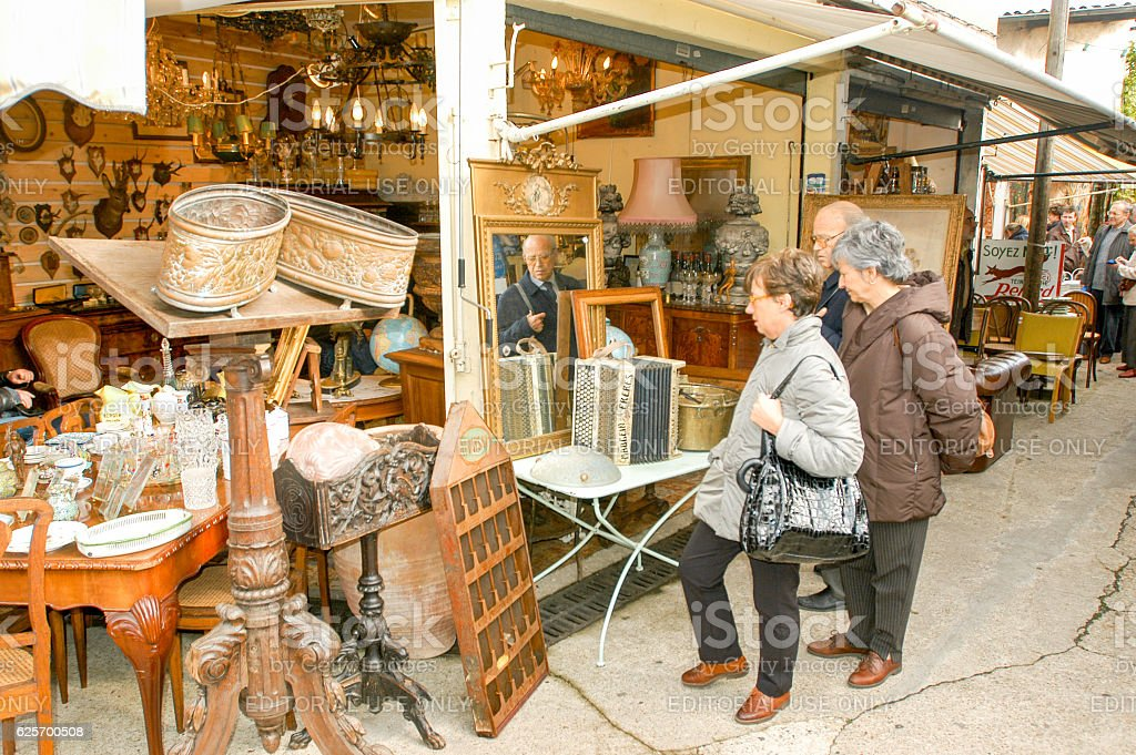 People shopping at the flea market of Clignancourt at Paris stock photo