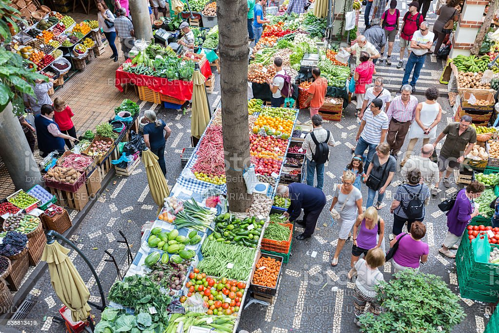 People shopping at the vegetable market of Funchal, Madeira Island stock photo