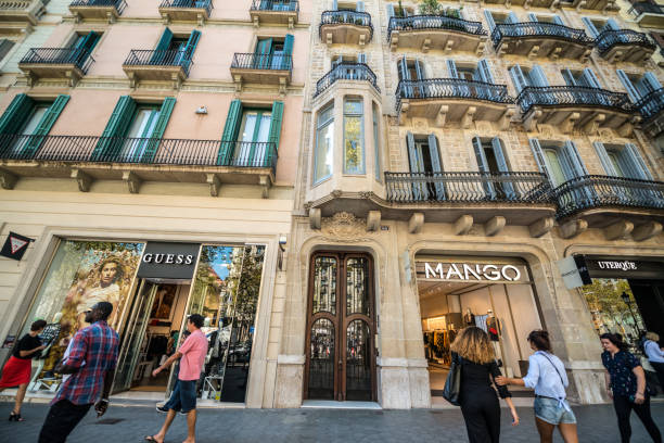 People shopping in Barcelona, Spain Barcelona, Spain - September 28, 2016: People shopping in Barcelona, Spain. passeig de gracia stock pictures, royalty-free photos & images