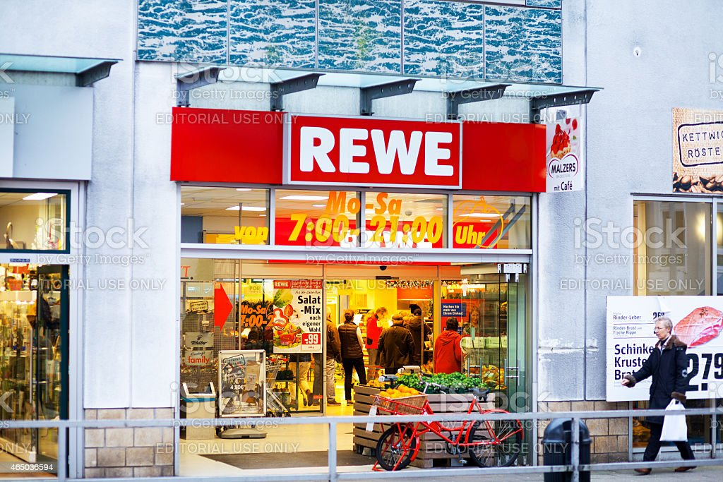 People shopping in Rewe supermarket stock photo