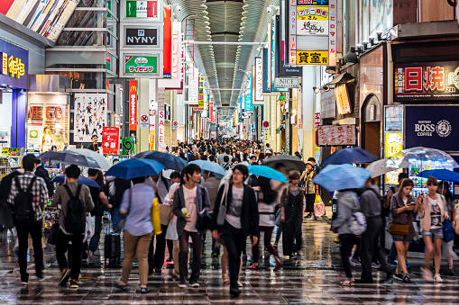 People shopping in Shinsaibashi on a rainy day
