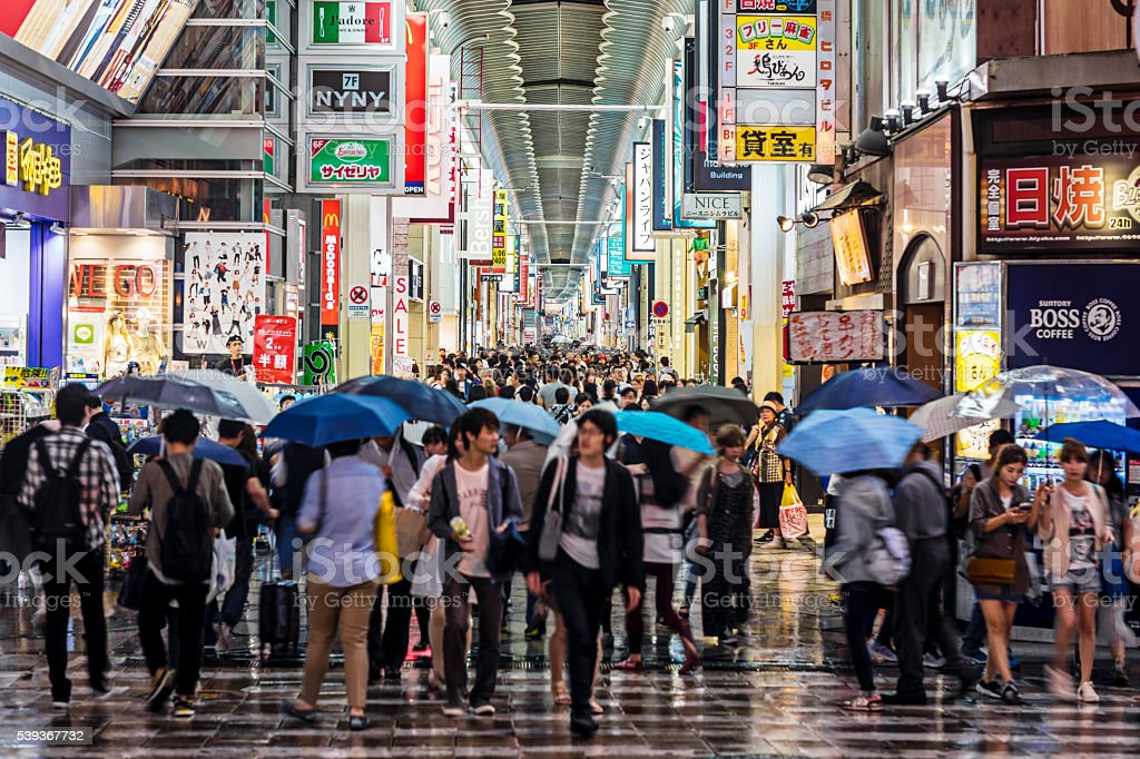 People shopping in Shinsaibashi on a rainy day stock photo
