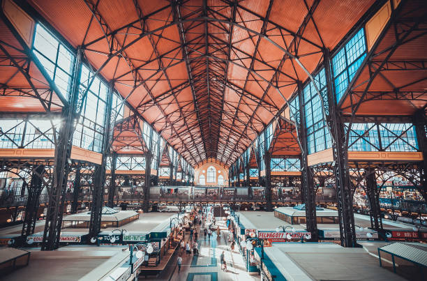 People shopping in the Great Market Hall. Great Market Hall is the largest indoor market in Budapest, it was built in 1896. stock photo