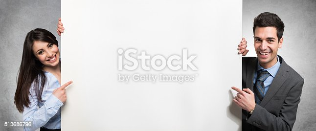 istock People showing an empty banner 513686796