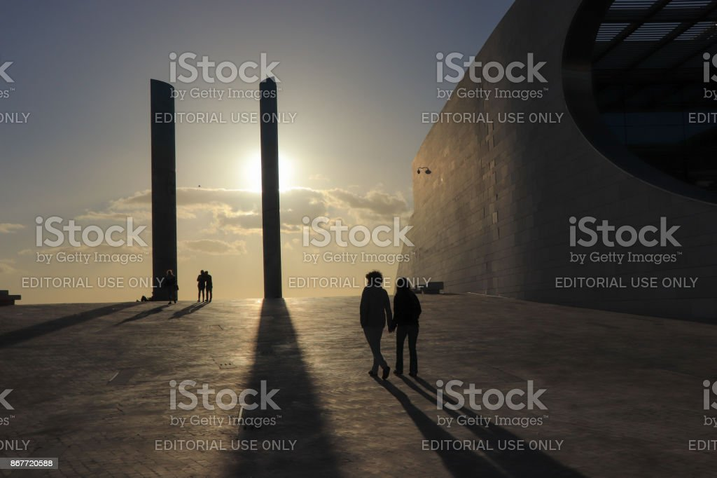 People silhouette at the sunset. architecture detail in the...