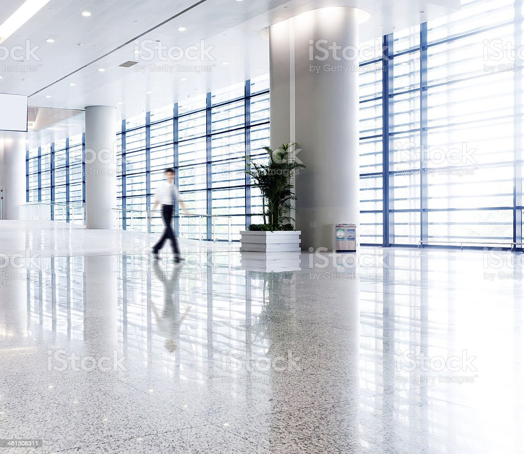 people silhouette in hall of office building stock photo