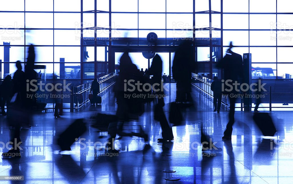 People silhouettes at airport building royalty-free stock photo