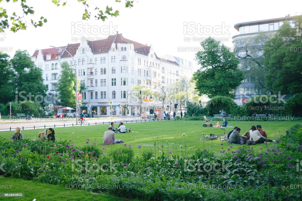 People sit and rest in a Park at Savignyplatz. royalty-free stock photo