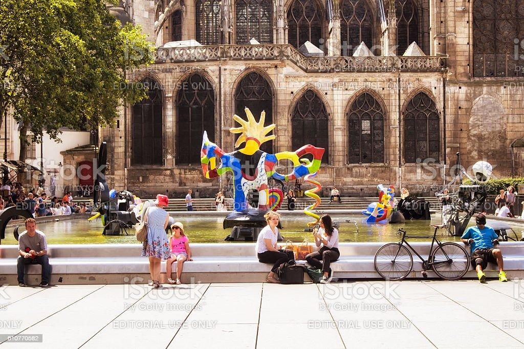 People sit around Stravinsky fountain stock photo
