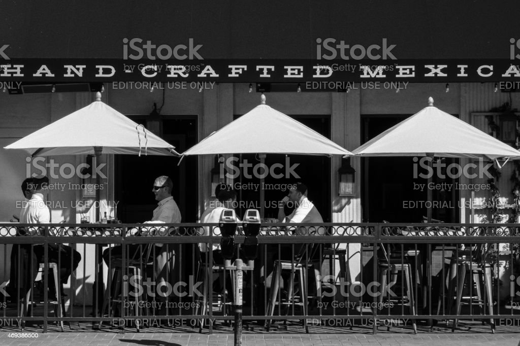 People Sit At A Restaurant In Downtown San Diego California Stock Photo Download Image Now