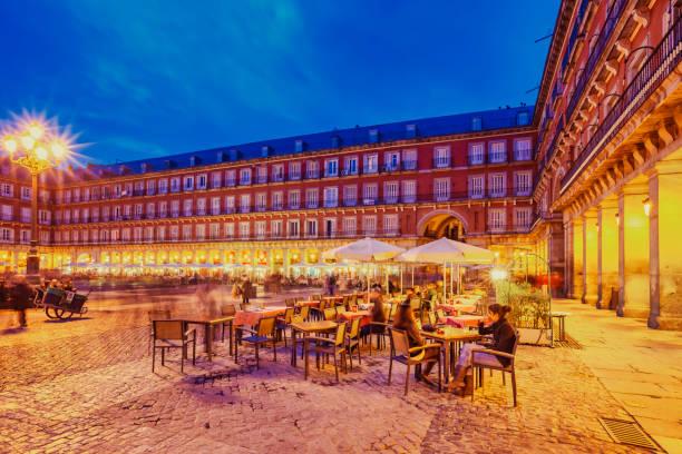 People Sit on Restaurant Patio Plaza Mayor Madrid Spain stock photo