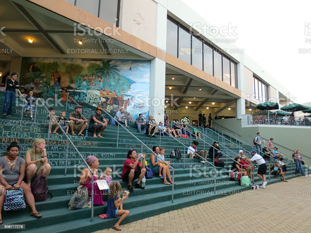 People sit on steps as they watch the Earth Day Concert stock photo