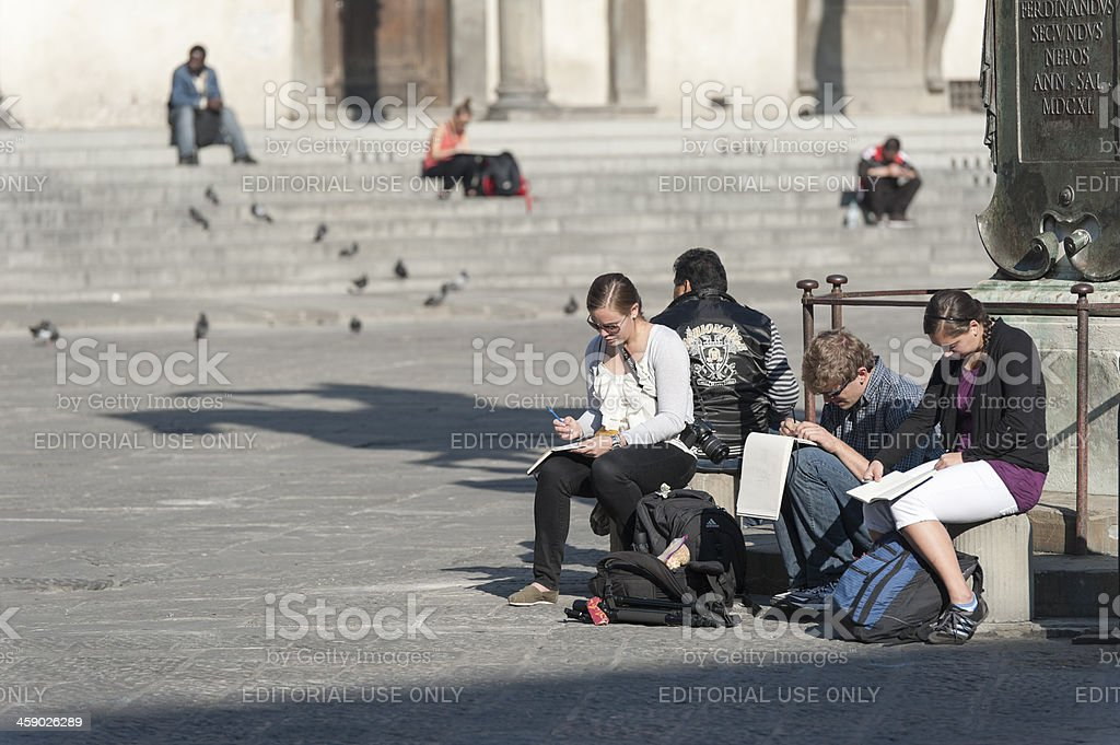 people sitting and drawing at piazza san marco royalty-free stock photo