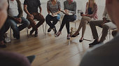 istock People sitting in a circle counseling 644997626