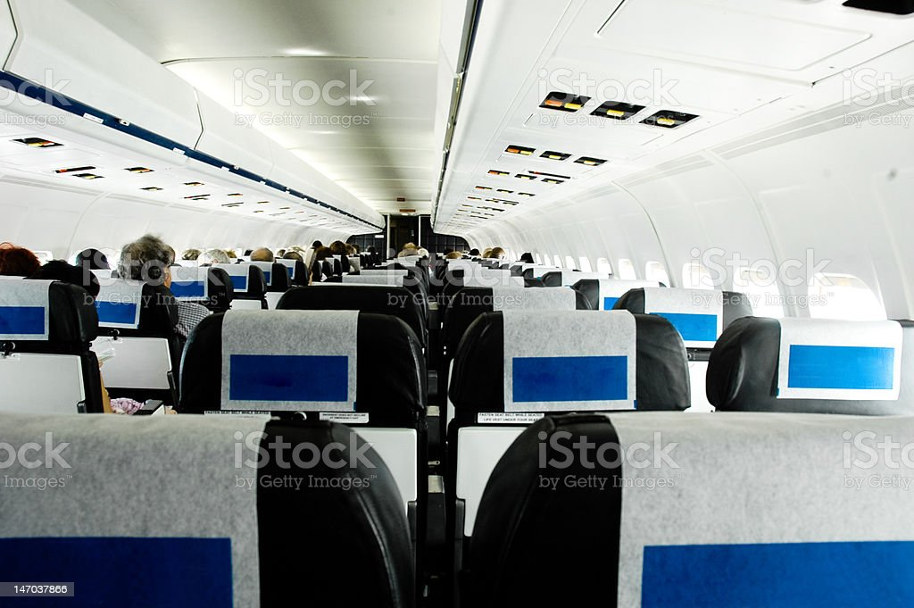People sitting in aeroplane, rear view stock photo