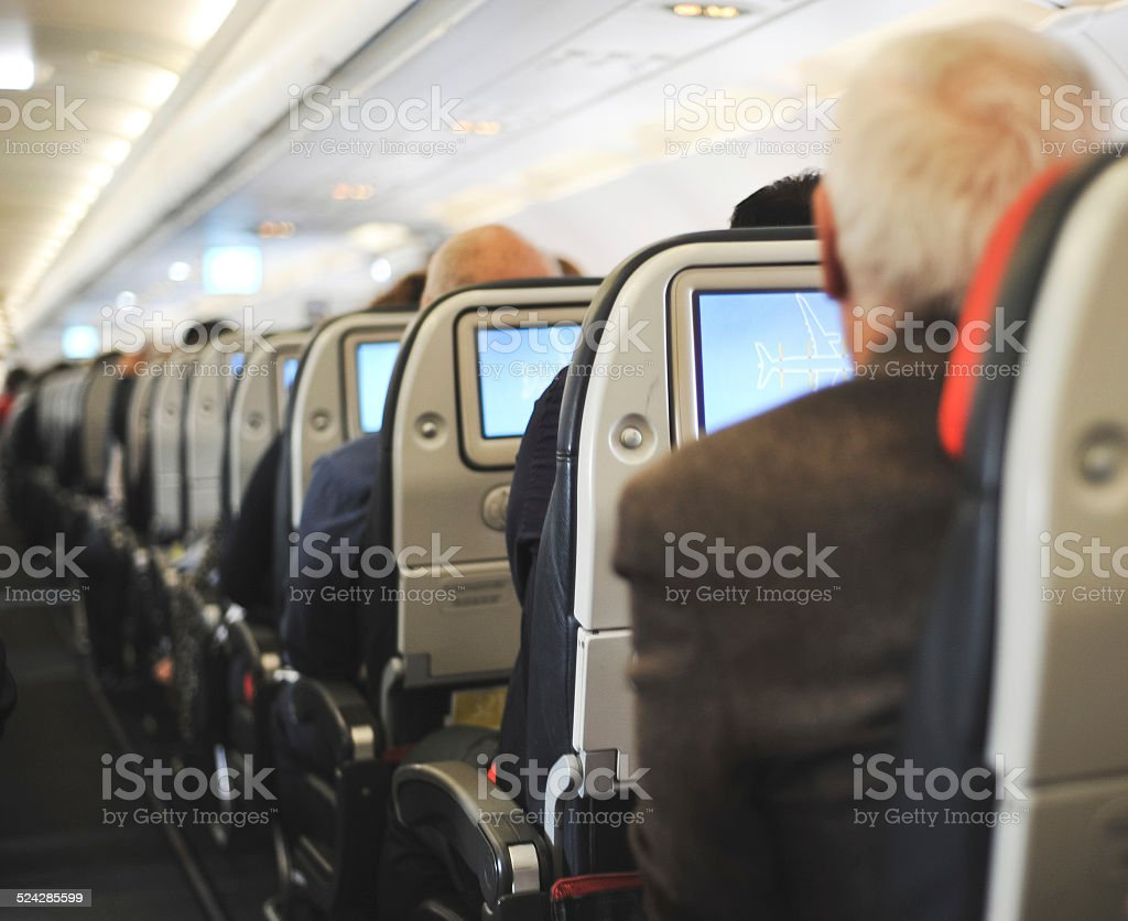 People sitting in an airplane stock photo