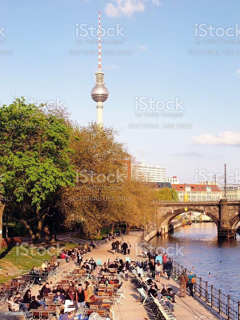 People sitting in beer garden at Spree River (Berlin) stock photo