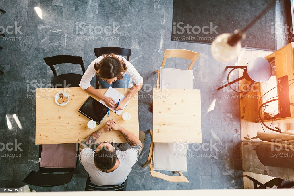 People Sitting In Cafe - foto stock