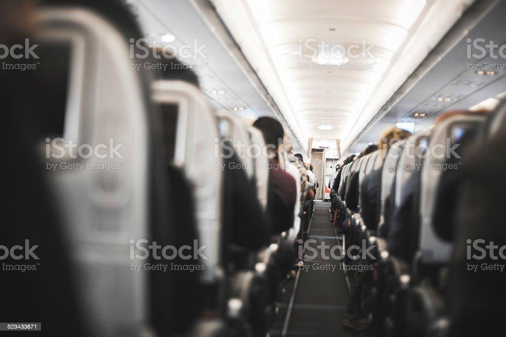 Gens à s'asseoir dans l'avion - Photo