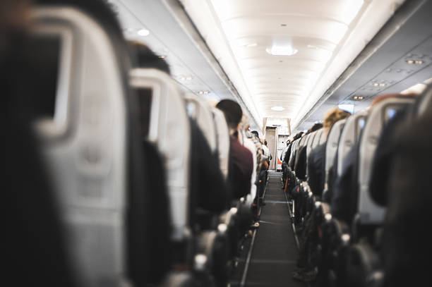 People sitting in the airplane stock photo