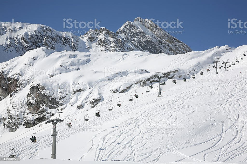 People Sitting in the Ski Lift stock photo