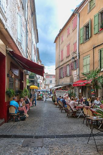 People Sitting On Terraces Of Restaurants In Les Vans France Stock ...