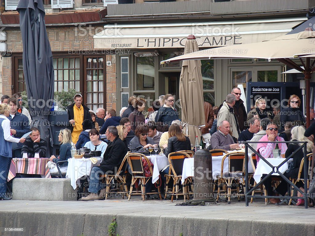 People Sitting on the Terrace of the Restaurant in France stock photo