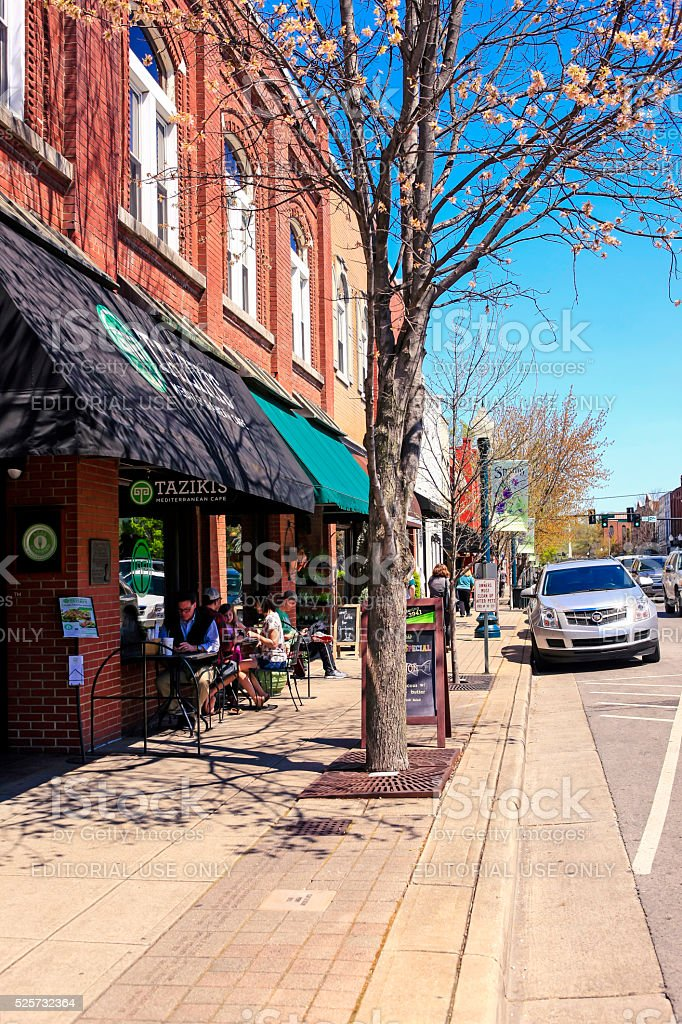 People sitting outside a cafe in downtown Franklin, Tennessee. stock photo