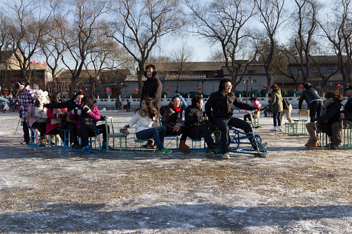 People skate on lake