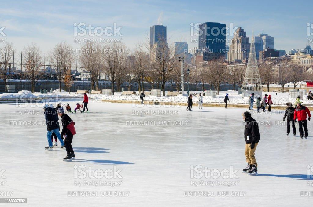 People skating at Old Port Ice Skating Rink