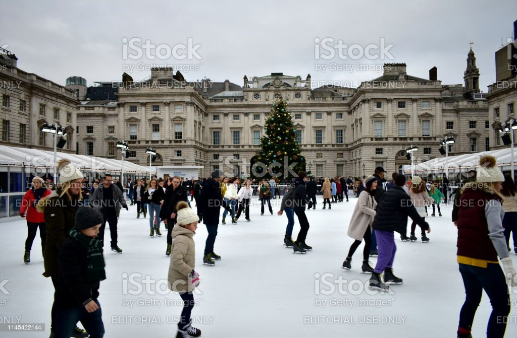 Christmas Ice Skating.People Skating On Ice At The Somerset House Christmas Ice Rink London United Kingdom Stock Photo Download Image Now