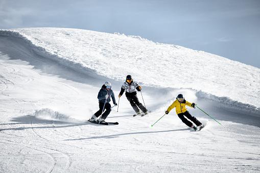 People skiing in Alps ski resort, Alpe di Mera, Piedmont, Italy
