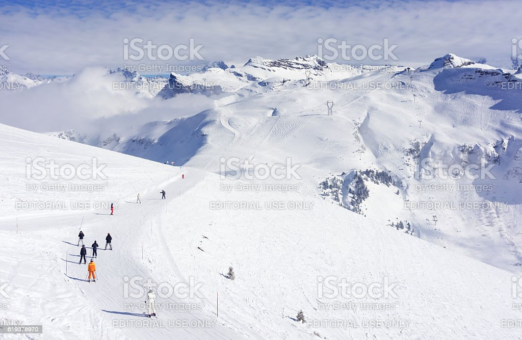People skiing in the Grand Massif ski area in France stock photo