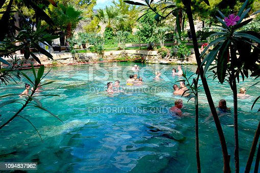 istock People smin in the antique Cleopatra's pool with thermal water under sunlight. 1094837962