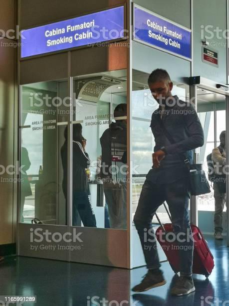 People smoking cigarettes within airport designated smoking area picture id1165991289?b=1&k=6&m=1165991289&s=612x612&h=pcraguqdocmzjuzu1qlb8qe bi6mqf5pofe1nmg9grg=